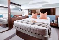 49-interior-owners-stateroom-american-walnut-satin-977x658