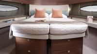 Princess-49-interior-forward-cabin-beds-together-1170x658
