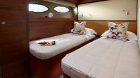 88-motor-yacht-interior-port-cabin-american-walnut-satin-hermes-1170x658